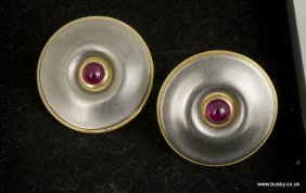 A pair of dichromatic 18ct gold disk shaped clip