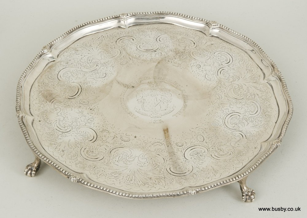 An early George III hallmarked silver salver on ball