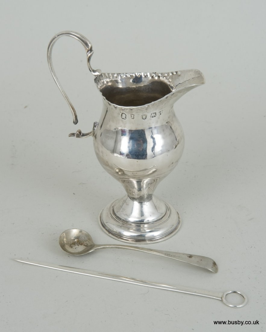 A George III hallmarked silver Chapeau ewer cream jug,