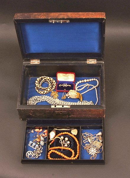 A jewel box containing sundry jewellery, including a