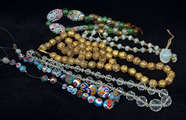Five various bead necklaces, including Venetian,