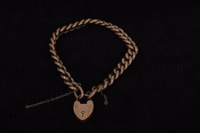 An Edwardian 9ct gold hollow curb bracelet with