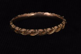 An Edwardian gold hollow stiff bangle with rope pattern