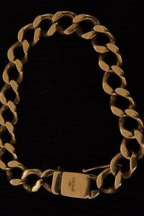 An 18ct gold curb bracelet, hallmarked, 43.5gms.