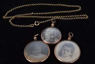 Three Edwardian 9ct gold photo pendants, two fully