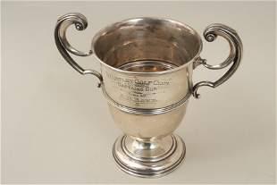 An Edwardian silver trophy cup with upright scroll