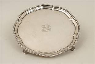 A George V silver salver with lobed and beaded border