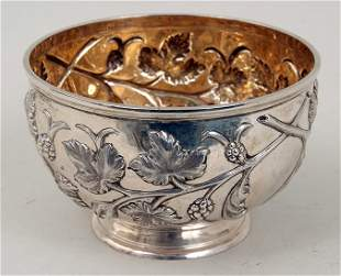 A Victorian silver bowl with gilt interior, embossed in