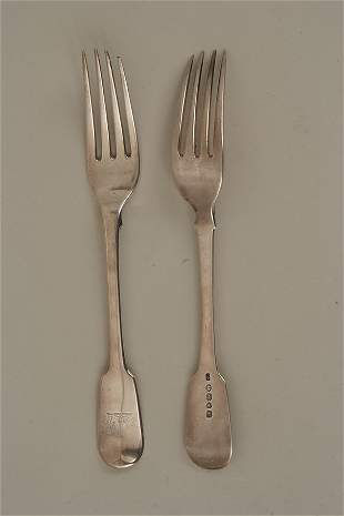 A pair of George IV fiddle pattern silver table forks,