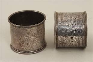 A pair of Edwardian silver napkin rings with bright-cut