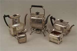An Edwardian four piece silver tea service of