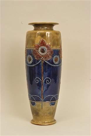 A Royal Doulton pottery vase of slender baluster form