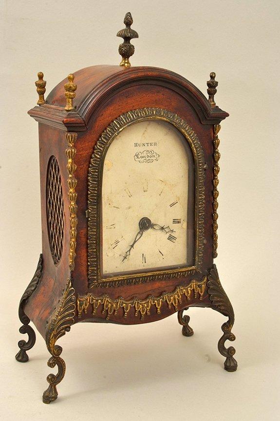 An antique ormolu mounted mahogany bracket clock, the