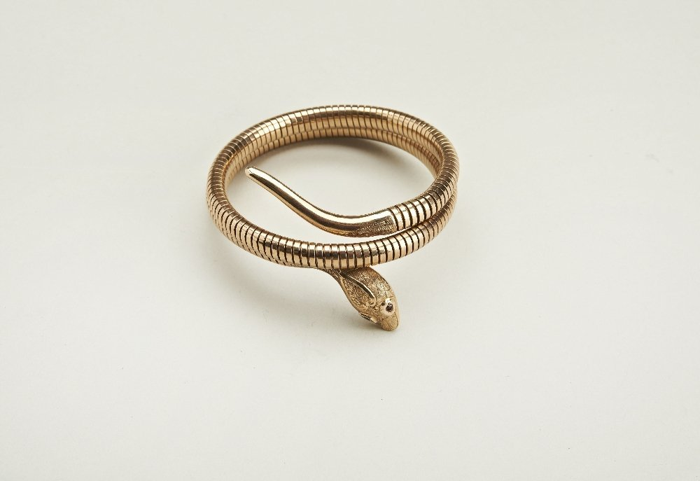 A Victorian 9ct gold snake head bangle, gas-pipe links