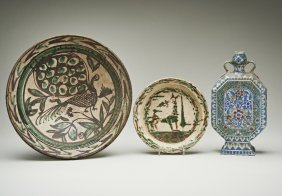 A lead glazed Islamic dish painted with a Peacock