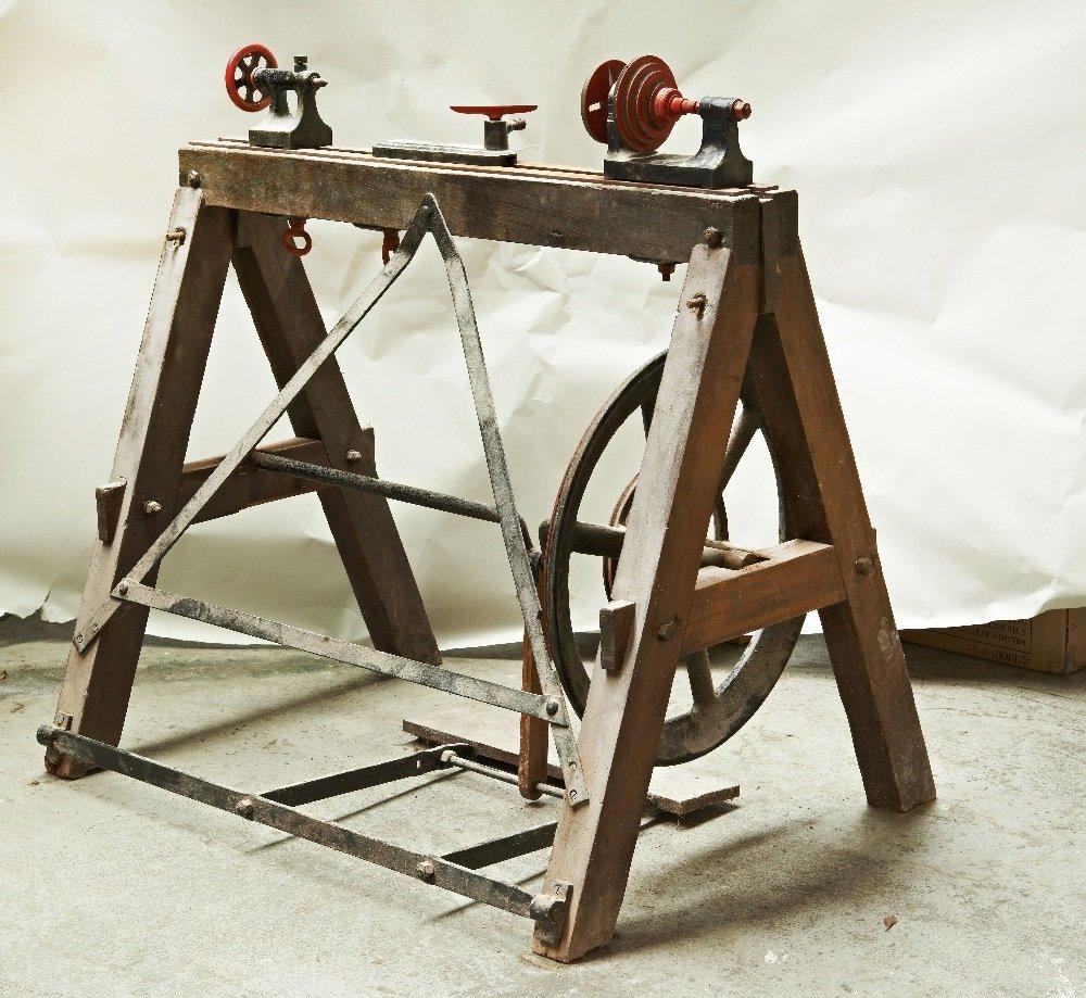 A Victorian cast iron wood turning treadle lathe.