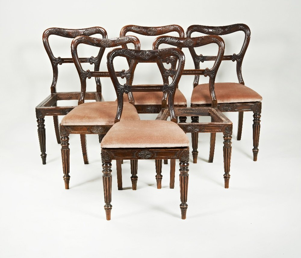 A set of six Regency imitation rosewood dining chairs,
