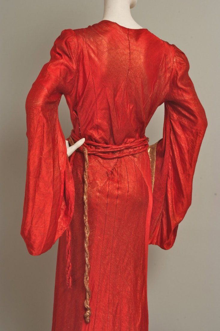 A 1930's gold lame and orange silk velvet gown.