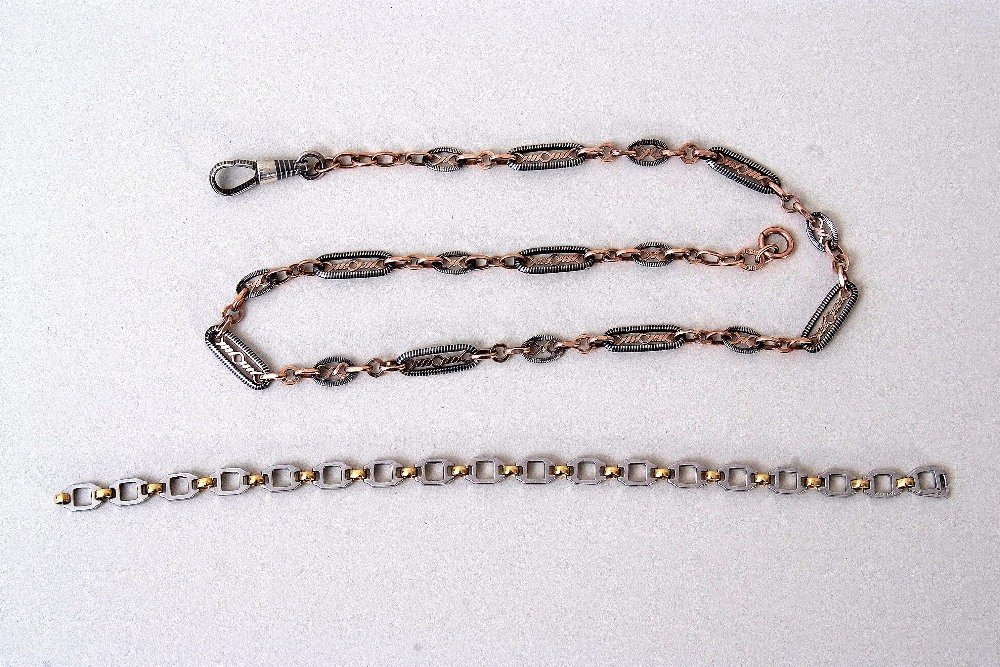 A Cartier gold and steel chain link bracelet, stamped,