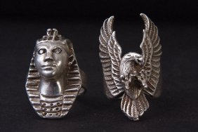 A white metal ring in the form of a Pharaohs head, with