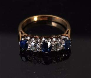 A diamond and kyanite five stone 18ct gold ring, set in