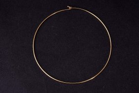 An Ivory Coast gold choker necklace, unmarked, probably