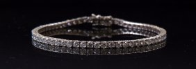 An 18ct white gold diamond line bracelet, set with