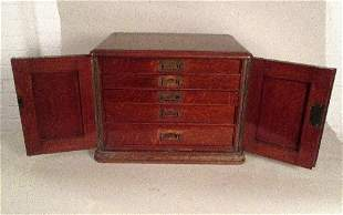 A Victorian oak five drawer canteen cabinet by Walker &