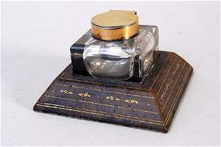 A silver gilt cut glass and leather mounted inkwell by