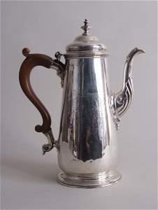 A George II silver coffee pot, London 1744, tapering