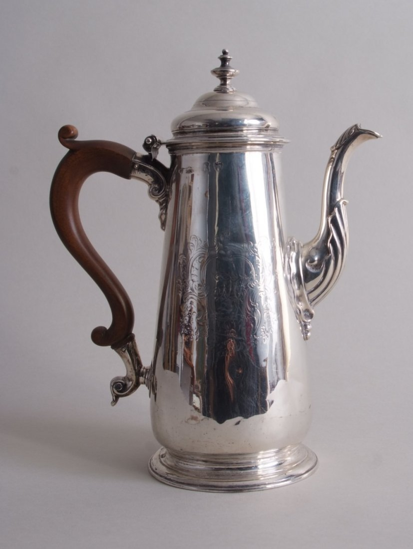 A George II silver coffee pot, London 1744, tapering