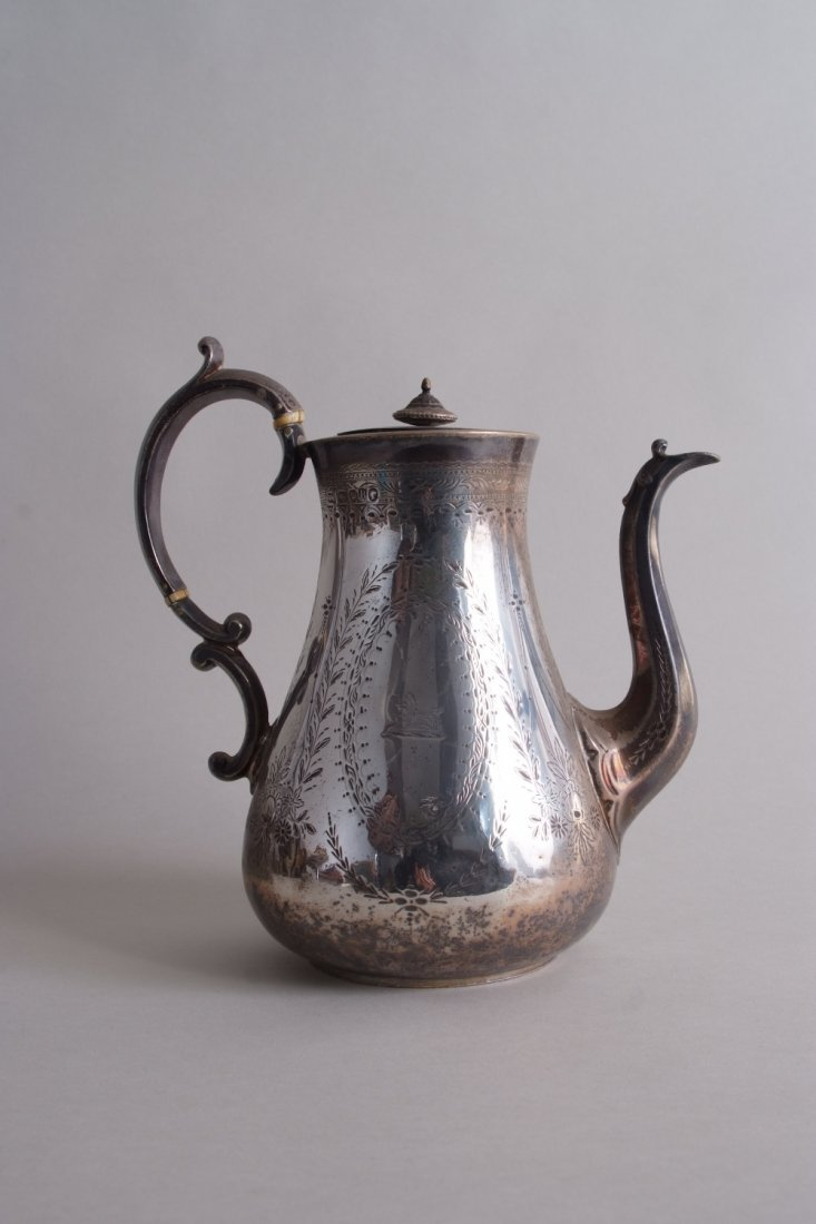 A Victorian silver coffee pot, by John Wakefield,