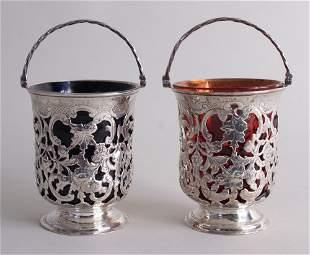 A fine pair of Victorian silver sugar baskets, marked