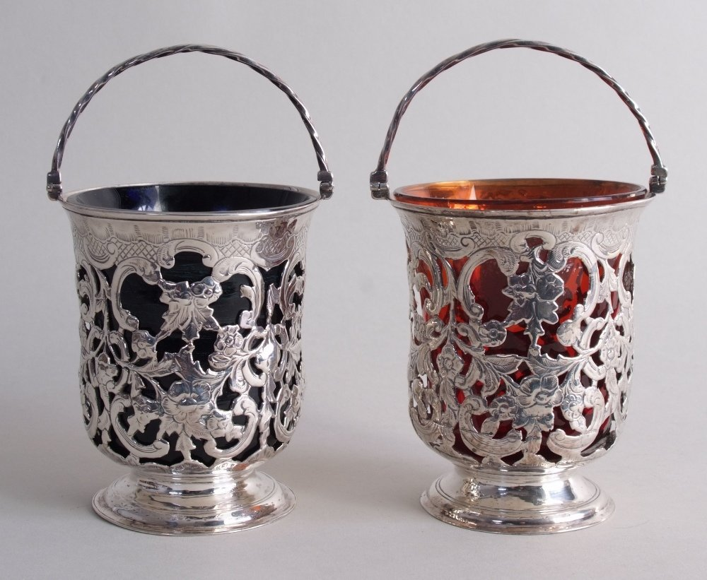 A fine pair of Victorian silver sugar baskets, marked