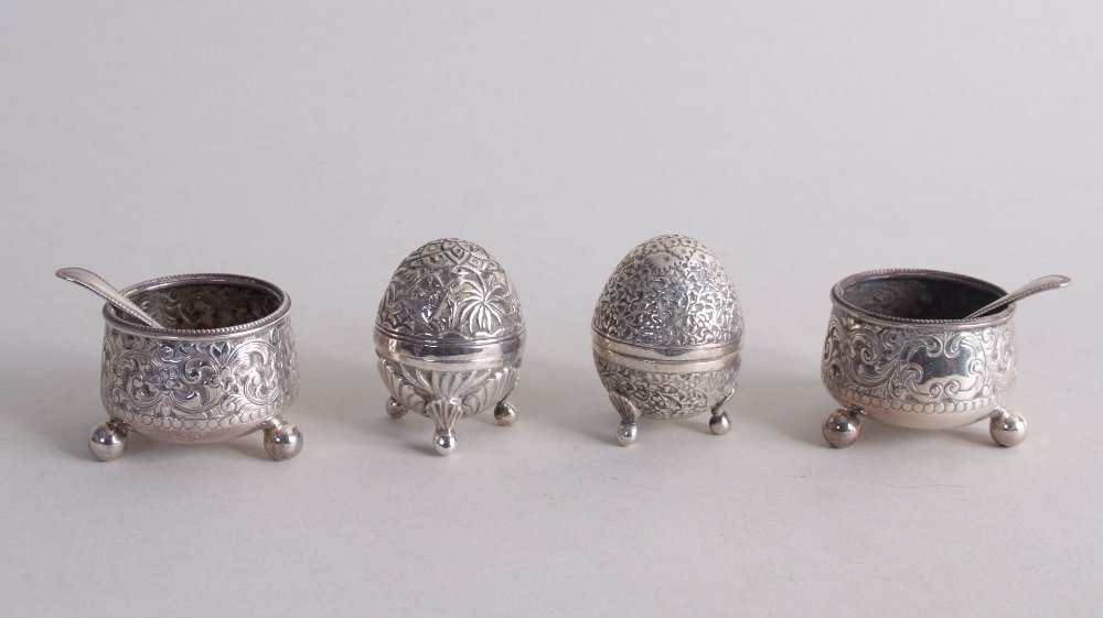 Two pairs of Victorian silver salts and pepperettes,