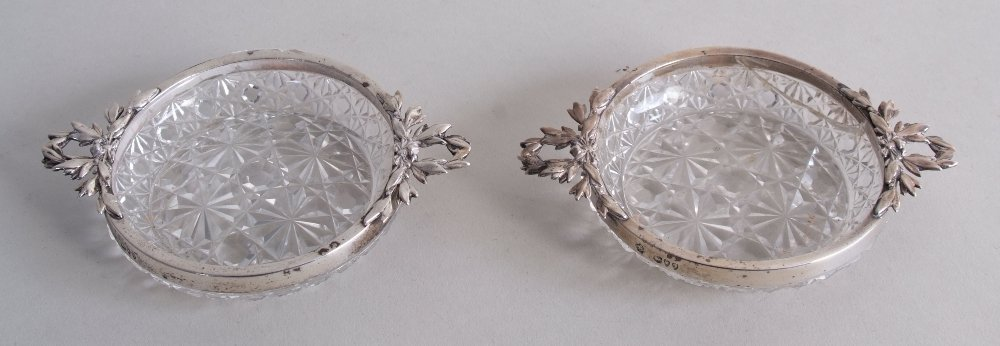 A pair of Victorian silver and cut glass trinket trays,