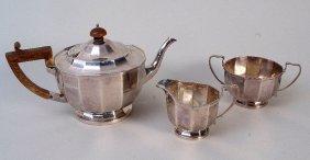 An Edwardian three piece silver tea set, by Martin,