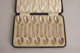 An Art Deco set of twelve silver and enamel tea spoons,