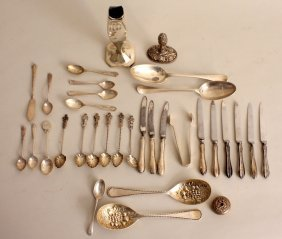 A mixed lot of silver and plated flatware, including