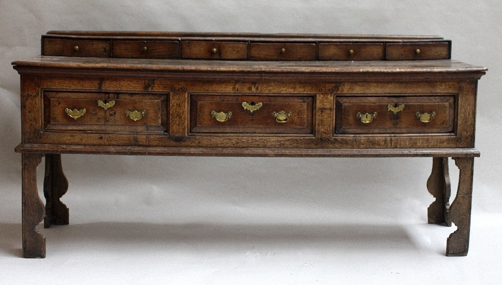 A late 17th century oak dresser base, six raised small