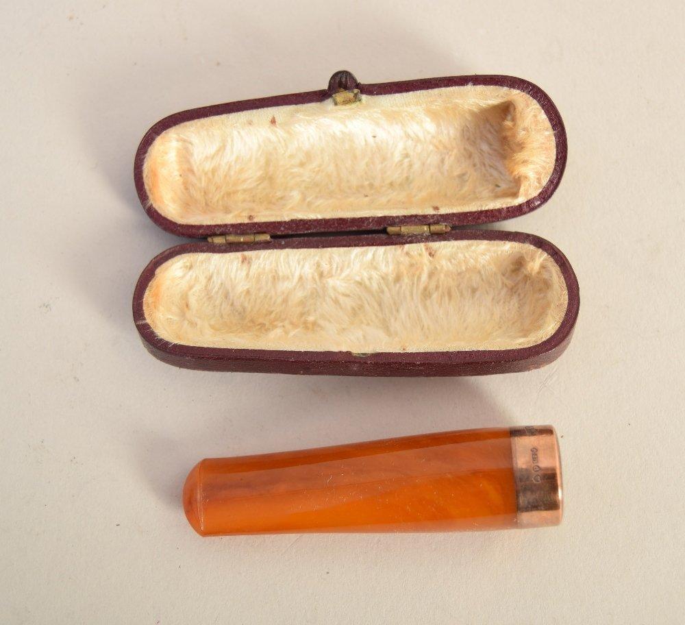 An Art Deco 9ct gold mounted amber cigar holder, N.C