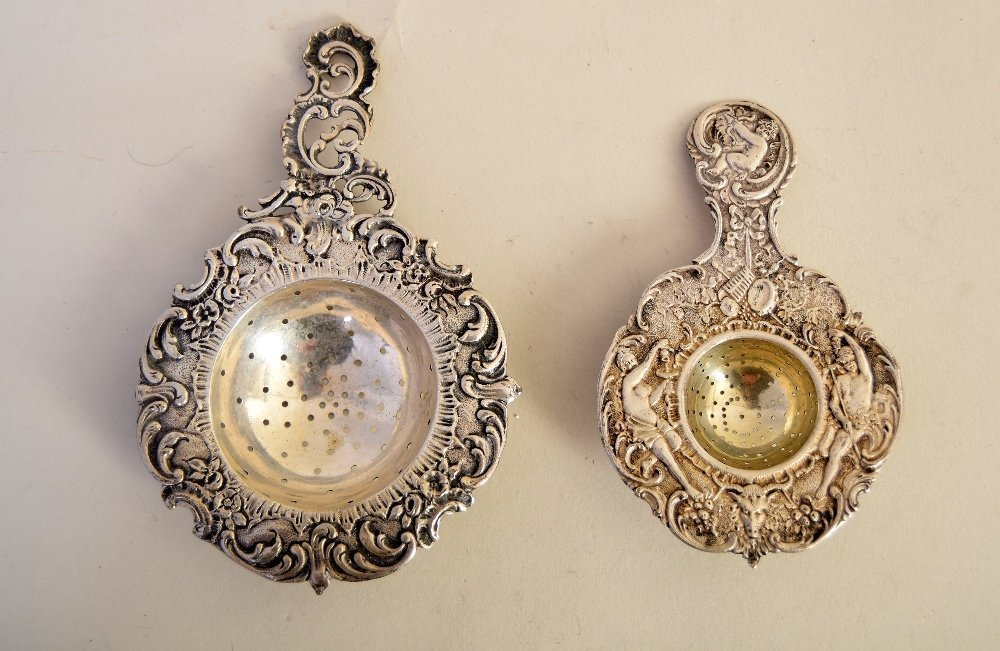 A 19th century Bavarian silver tea strainer, decorated
