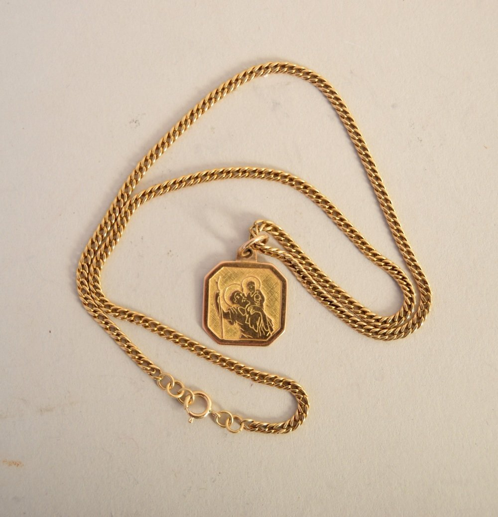 An 18ct gold chain with suspending fob of St