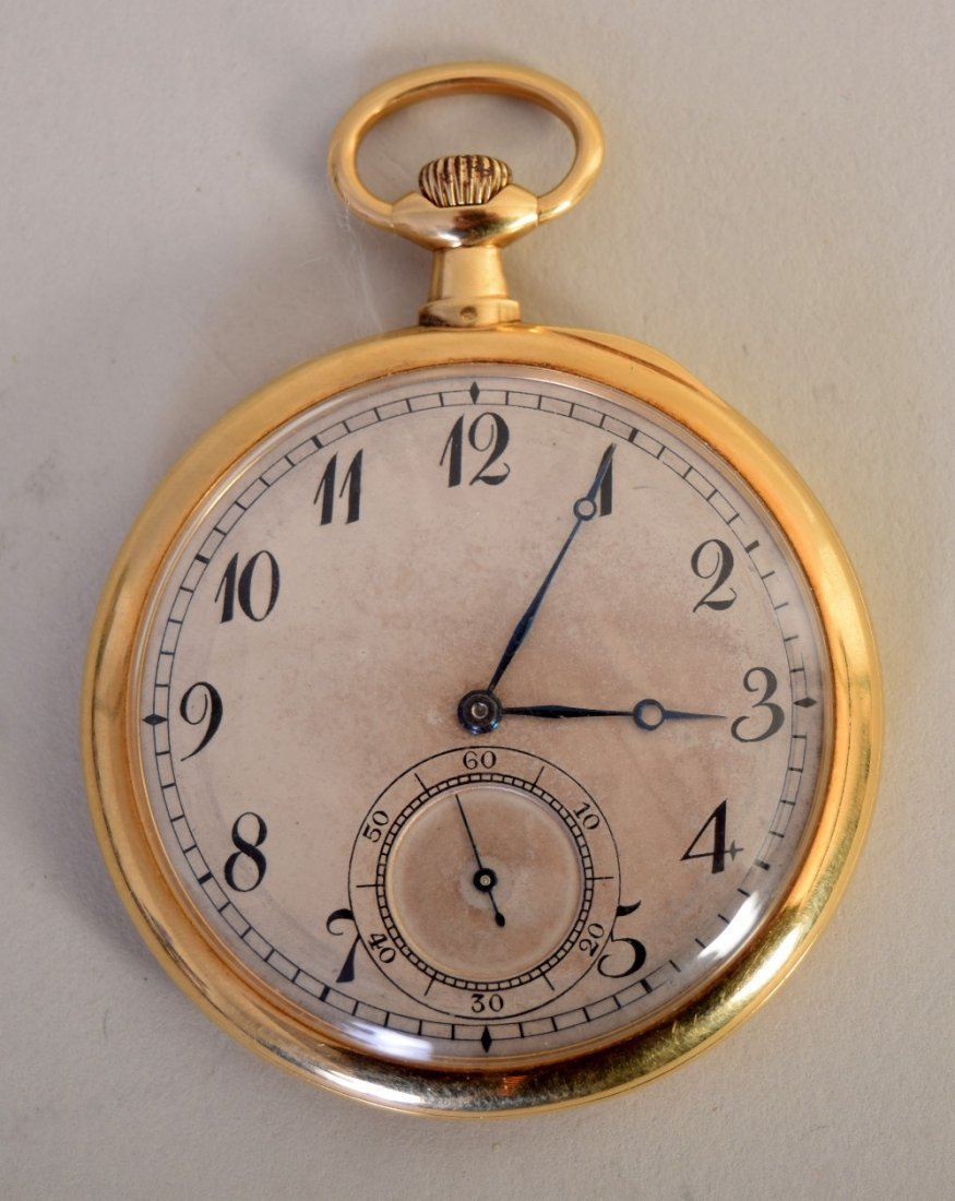 An 18ct gold open face pocket watch, of slim