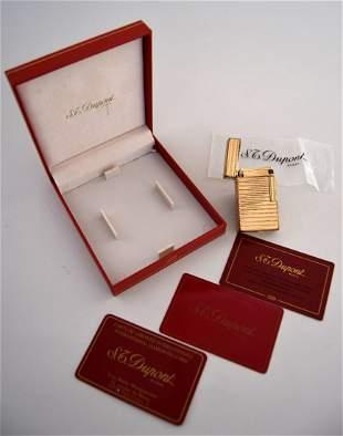 An S.T.Dupont lighter horizontal stripe, 18k gold size