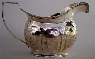 A George III silver cream jug, London 1806, 9cmH, 3.8oz