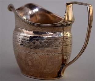 A George III silver cream jug, London 1805, with weave