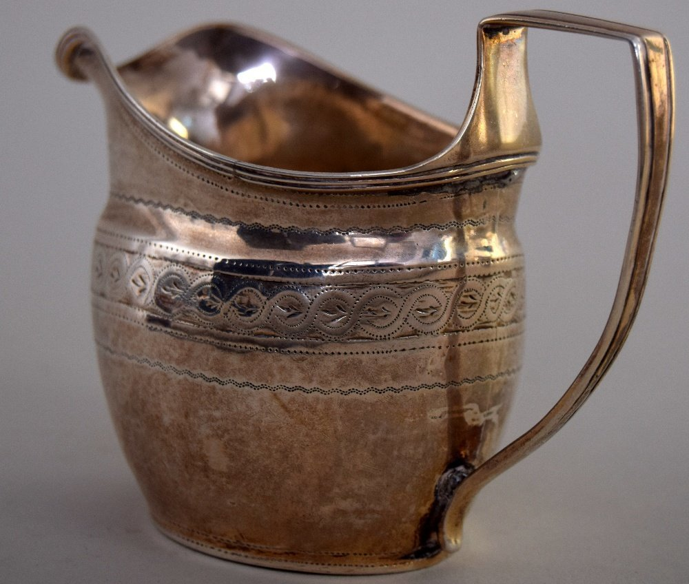 A George III silver cream jug, London 1805, with weave