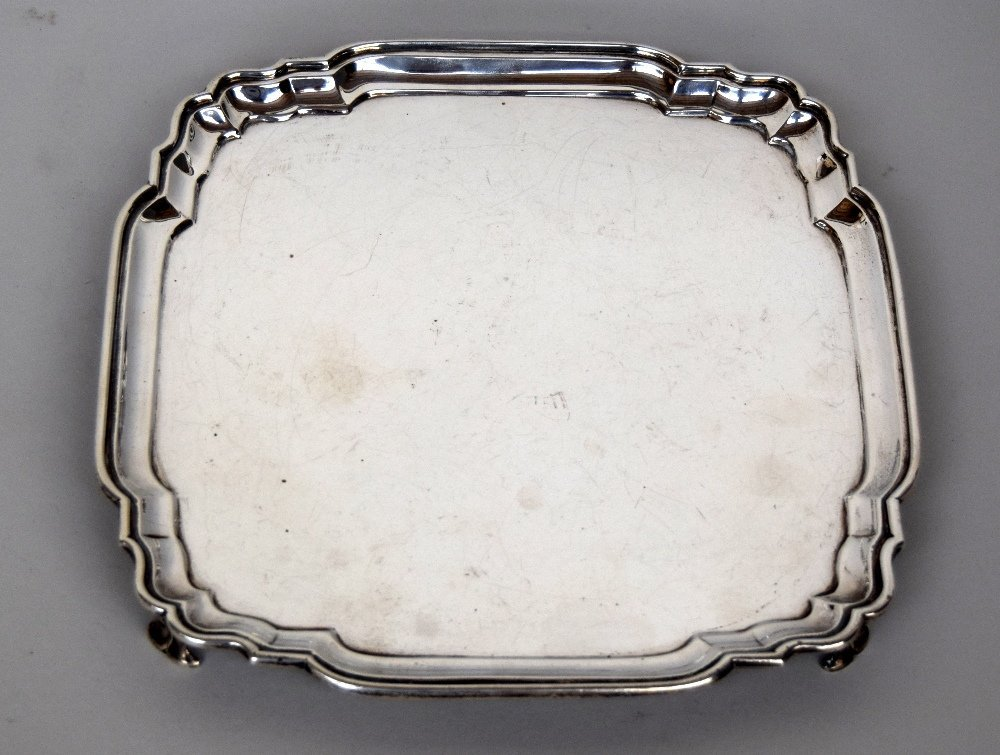 A George V silver salver raised on four feet by C.S.