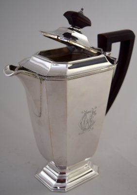 An Art Deco style coffee pot of faceted rectangular
